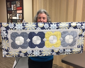 A soft blue flower table runner to usher in Spring!