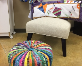 This colorful cushion will brighten your room!